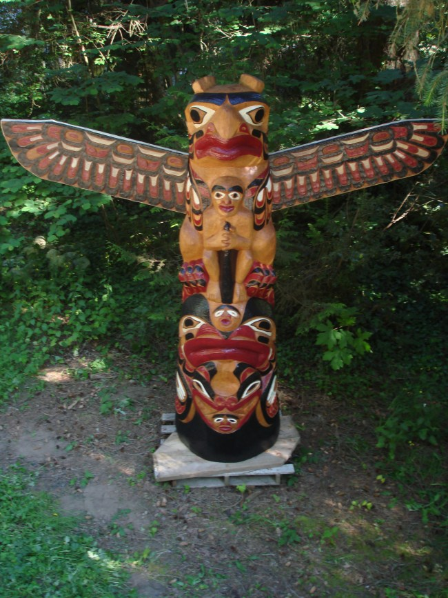 The positive cedar sculpture served as a mold for two other fiberglass poles