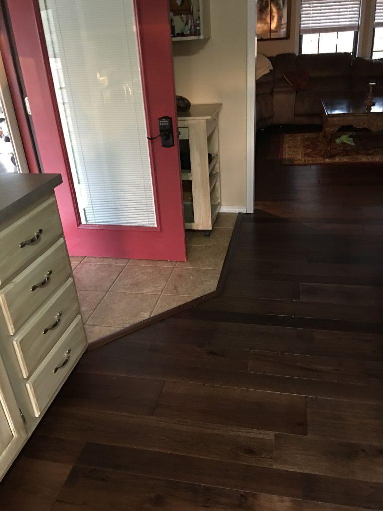 Dark brown prefinished multi-width engineered hardwood floor installed in a living room