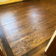 """Aacer red oak with 5"""" walnut border finished with Bona Craft Oil in a Cedar Rapids home."""