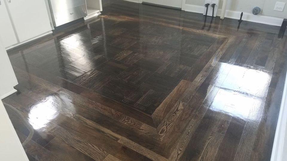 Random species dark stain sand and finish hardwood floor