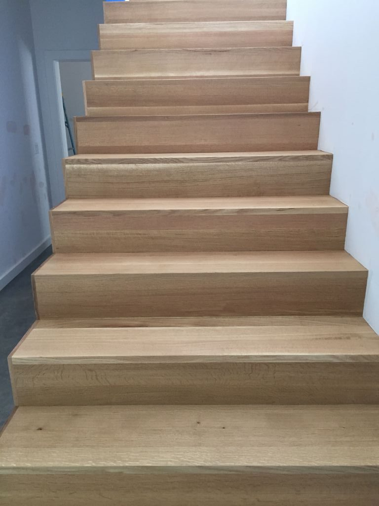 New residential build with white oak floors and stairs