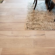 This flooring was used throughout the entire house (with the exception of bathrooms and the utility room). The prefinish selection and wide plank were the perfect choice in this remodel to bring in more natural finishes and light colors.