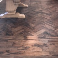 "Storehouse ""Barrel"" White Oak floor from Real Wood Floors installed in a herringbone pattern in Altus, OK."