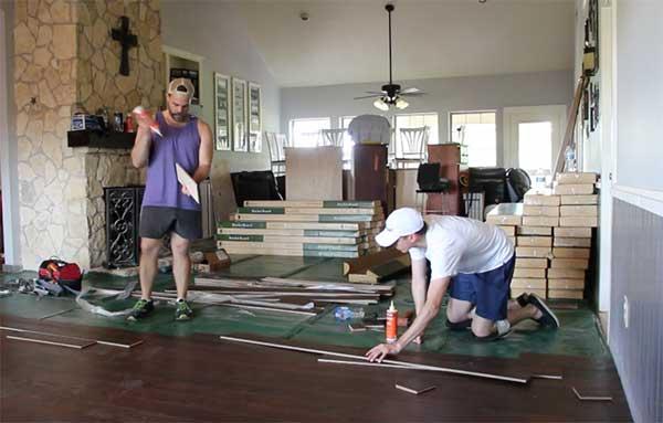 Employees installing new floor
