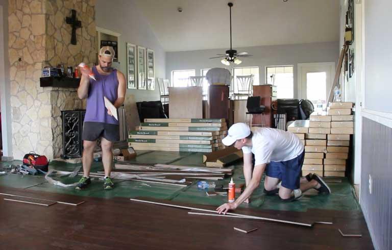 Installing a new floor at Still Creek Ranch in Texas.