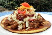Red Neck Tacos are a far cry from the traditional Taco you and your family may be used to having made with tender delicious Pulled Pork doused in the finest barbecue sauce resting on a delicious corn cake, topped with homemade crunchy coleslaw, fresh ripe tomatoes, and cheese.