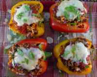 Stuffed # Peppers with #Italian #Sausage and Valencia Rice Topped with #Asiago Cheese.