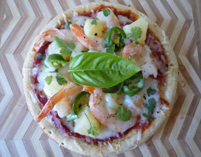 This awesome simple to make the recipe for Shrimp and Pineapple Personal Pizza with jalapeño hits all the mouths keen senses combining a flavor burst of Spicy jalapeño, sweet oh so Juicy FRESH pineapple, and wonderful succulent shrimp from our own Gulf Coast here in sunny Florida.