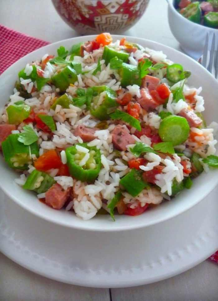 This wonderful recipe for Creole Tomatoes Okra and Rice contains sweet juicy ripe Creole Tomatoes along with Okra and can be served in many ways. It can be used as a side dish to compliment your meal or as a main dish.Creole Tomatoes Okra and Rice contains Andouille Sausage and bacon drippings.You may choose to omit those ingredients to convert to a Vegetarian Dish if desired. It's one the MOST amazing Southern Louisiana Creole Dish.