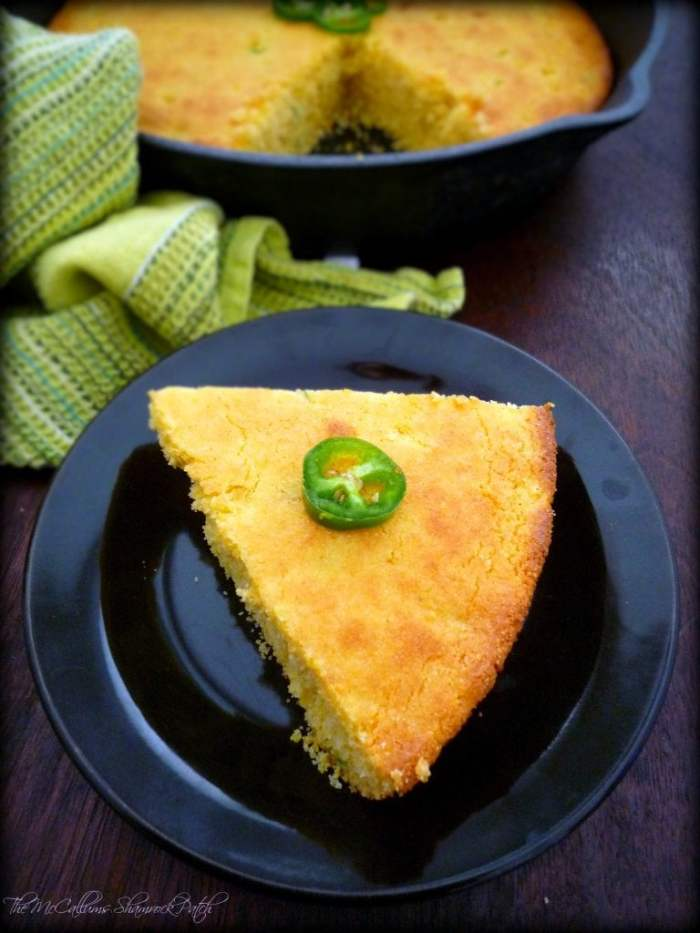 This dessert-like Sweet Southern Cornbread is going to take your family by storm combining cornmeal, buttermilk, cheese, eggs, organic non-GMO verified corn, and spicy jalapeño peppers all baked in an old-fashioned cast iron skillet to perfection.