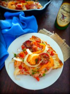 Cajun Style Andouille and Shrimp Pizza is one fantastic lunch or dinner menu item with spicy andouille sausage, delicious shrimp seasoned with Cajun Spices, then topped with spicy tomatoes, onions, red and yellow bell peppers, and warm gooey cheese.