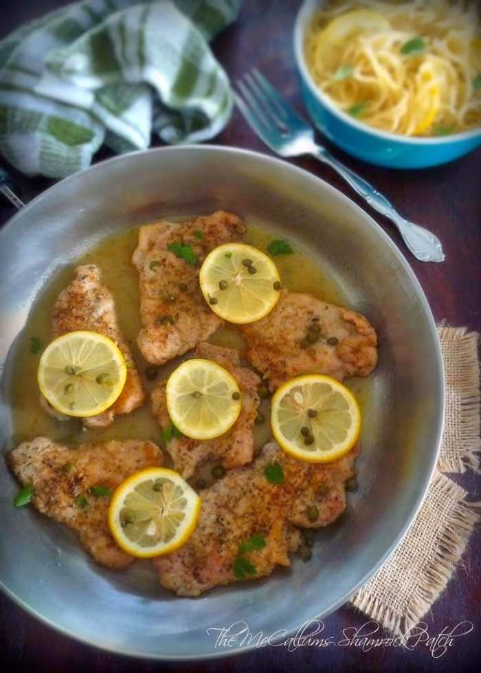 Pork Piccata with lemon and Capers is a deliciously simple Italian-American classic dish made from tender pork tenderloin slices that have been simply seasoned with kosher salt, freshly ground peppercorns, dredged in all-purpose flour, then sautéed in a combination of authentic olive oil and unsalted butter. The pan drippings are used to make the delicious sauce by adding chicken broth, white table wine, lemon juice, and capers.