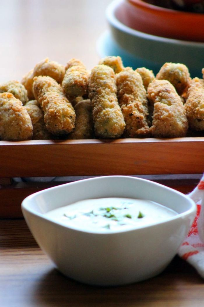 Southern Fried Dill Pickles are made from delightfully crunchy, tiny baby dill pickles, that are gloriously soaked in a garlic and dill brine until perfectly seasoned, then placed in seasoned buttermilk and hot sauce brine before fried to perfection
