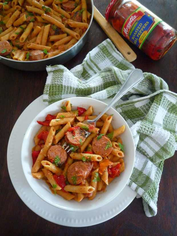 A bold, bright, summer is right around the corner and I want to share a simple to make, fun, Cajun-Inspired Penne Pasta, and Bold, Bright, Summer Giveaway sponsored by Mezzetta. This Cajun-Inspired Penne Pasta is made with pure Southern love combining penne pasta, grilled Andouille sausage, a creamy cheese sauce, diced tomatoes with chiles, Mezzetta Roasted Red Peppers, onions, fresh herbs, and spices.