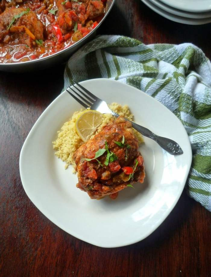 Hunter-Style Chicken {Chicken Cacciatore } looks impressive but really it's so simple and easy to make. All you'll need to make this delicious tasting Hunter-Style Chicken is chicken thighs, onions, chopped bell peppers, tomatoes,fresh minced garlic, kosher salt, freshly ground pepper, red wine, olive oil, flour, thyme, fresh basil, and a touch of oregano.