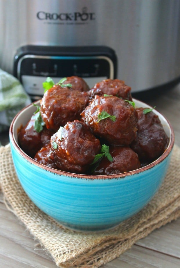 These delicious boozy Southern-Style Bourbon Meatballs are going to be the hit of your next gathering; be ready for people to immediately run over to the meatballs on the buffet table and beg for this retro Southern recipe