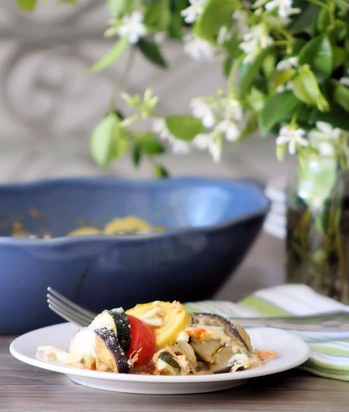 The remarkable looking Provençal Vegetable Tian is definitely a super simple showstopper you can make to impress your family and friends alike; made with organic garden fresh vegetables such as; zucchini, vibrant yellow squash, tender purple eggplant, onions, and juicy plum tomatoes that have a marvelous cheese topping.