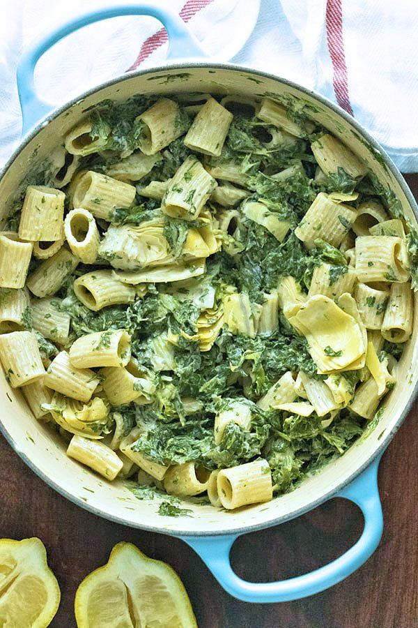 Rich and creamy Spinach Artichoke Pasta is totally dairy free and only takes about half an hour to make. It's easy enough for a weeknight meal but fancy enough for a date night or dinner party.