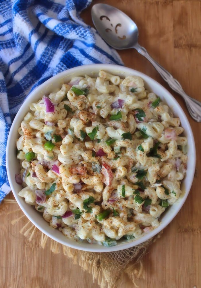 This Classic Southern Macaroni Salad screams flavorful and delicious! Combining elbow macaroni, chopped pickles, red onion, red pimentos, green bell peppers, creamy Duke's mayonnaise, chopped hard-boiled eggs, and garnished with a little paprika.