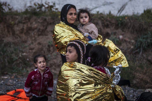 LESBOS, GREECE - OCTOBER 29: Refugees crossing the Aegean sea are seen after reaching the Greek island of Lesbos on October 29, 2015. Refugees who begin a journey with a hope to have high living standards away from conflicts, use Greece's Lesbos Island as a transit point on their way to Europe. (Photo by Javi Julio/Anadolu Agency/Getty Images)