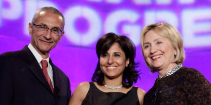 Former Secretary of State Hillary Clinton (R) poses with President of the Center for American Progress (CAP) Neera Tanden (C) and CAP founder and Chairman John Podesta at the 10th Anniversary policy forum in Washington, October 24, 2013. REUTERS/Yuri Gripas (UNITED STATES - Tags: POLITICS BUSINESS)