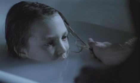 This little girl is creepy as hell!