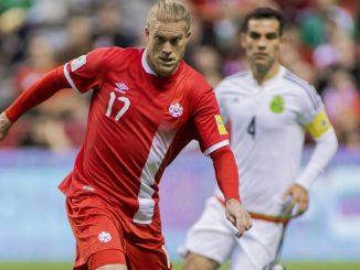 Canada's Marcel de Jong running past a defender.
