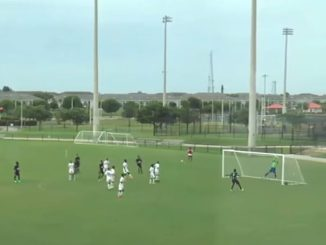 The goalkeeper jumps but can't reach a header falling into the very top corner of the net.