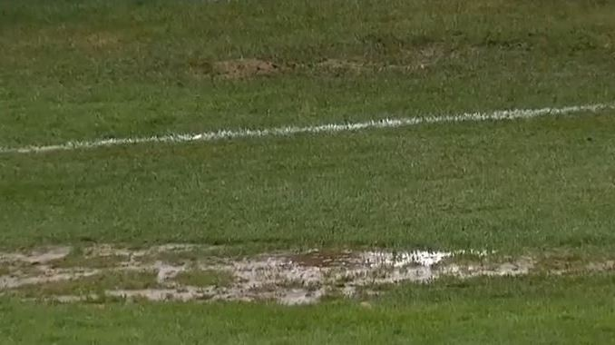 A massive hole full of standing water on the left side of Cavalry's Spruce Meadows pitch.