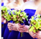 Bridesmaids in royal blue with green flowers looks very striking