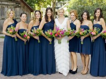 Amy Smart's bridesmaids wore midnight-blue Ann Taylor dresses and carried bouquets of zinnias and roses