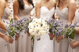 Bridesmaids in taupe with lavender bouquets