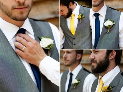 Groom and groomsmen in navy and yellow colour scheme. Grey suits tie in nicely with these colours.