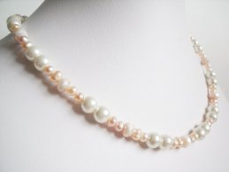 Bridal pearl necklace, by blingblingweddings on etsy.com