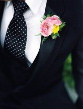 Black suit and spotted tie