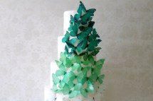 Wedding cake with emerald butterflies