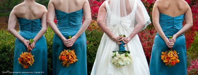 Bridesmaids in teal with orange bouquets