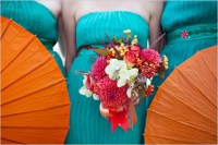 Bridesmaids in teal with orange parasols