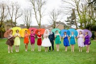 Bridesmaids in rainbow dresses with matching parasols {via boho-weddings.com}