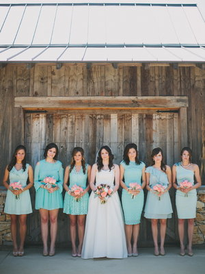 Bridesmaids in shades of mint and light blue {via projectwedding.com}