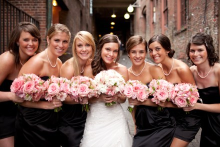 Bridesmaids in black with light pink bouquets {via bloomweddings.wordpress.com}