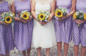 Bridesmaids in purple polka dot dresses {via my1950swedding.tumbler.com}