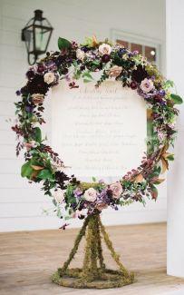 Beautiful floral wreath around the reception menu {via southernweddings.com}