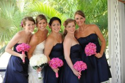 Bridesmaids in navy with pink bouquets {via crystalblueweddings.com}