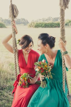 Bridesmaids in emerald and ruby red {via bridalmusings.com}