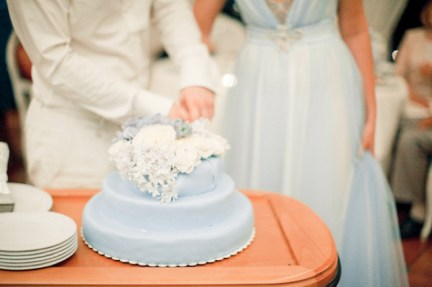 Powder-blue wedding cake {via burnettsboards.com}