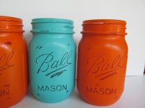 Turquoise and orange mason jars for centrepieces - www.etsy.com/shop/Theretroredhead2
