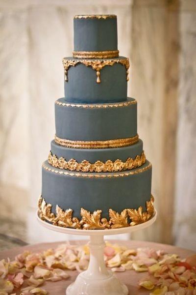 Grey and gold wedding cake via indulgycom  The Merry Bride