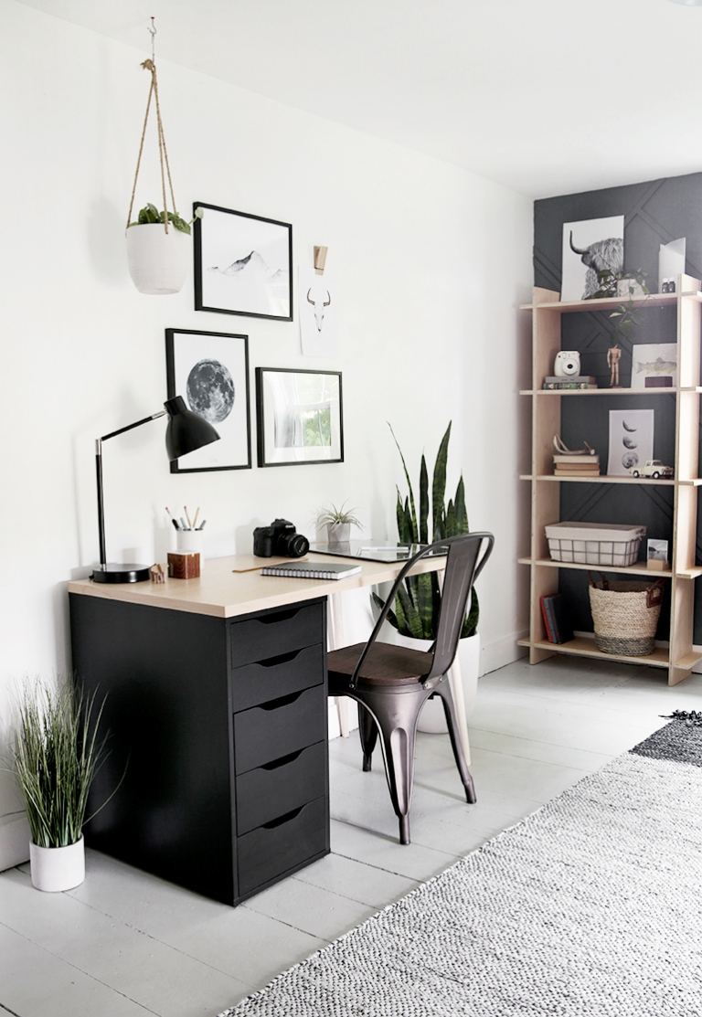 room with desk artwork and wood shelves