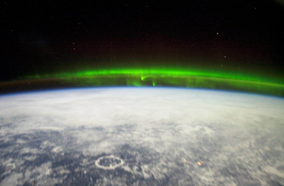 aurora, earth and stars